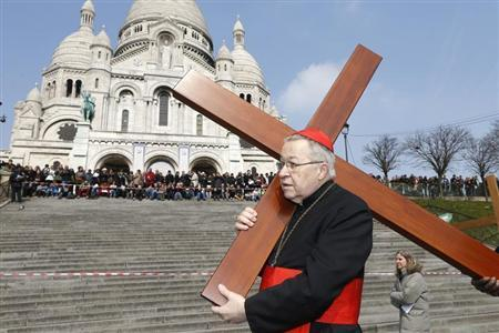 French Archbishop of Paris Cardinal Andre Vingt-trois carries a cross in the gardens of the Montmartre's Sacre Coeur Basilica during the annual Good Friday ''Stations of the Cross'' procession in Paris March 29, 2013. REUTERS/Charles Platiau