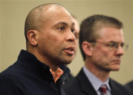 Massachusetts Governor Deval Patrick (L) speaks to reporters alongside FBI Special Agent in Charge in Boston Richard DesLauriers during a news conference held to discuss the explosions at the Boston Marathon in Boston, Massachusetts April 15, 2013. REUTERS/Jessica Rinaldi