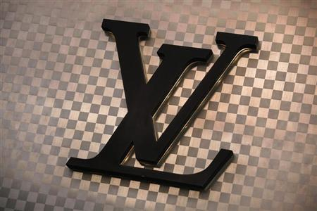A Louis Vuitton logo is seen outside the store at Hong Kong's Tsim Sha Tsui shopping district March 10, 2013. REUTERS