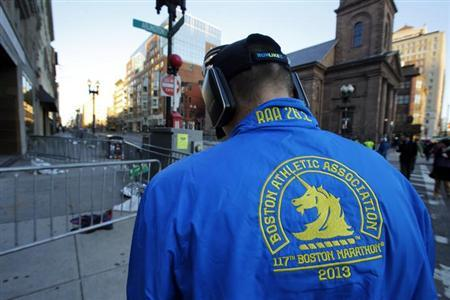 A man wearing a Boston Marathon runner's jacket is seen near the finish line of the race in Boston, Massachusetts April 16, 2013. REUTERS/Brian Snyder