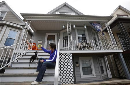 Kristen Cirullo plays with her dog ''Bocce'' on the front steps of her home in Chicago, Illinois, April 14, 2013. REUTERS/Jim Young