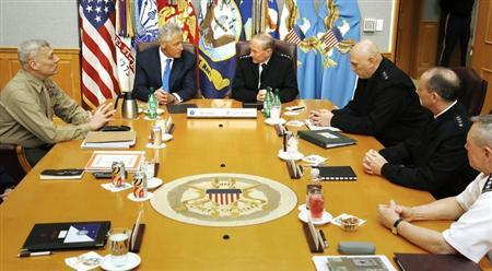 U.S. Secretary of Defense Chuck Hagel (2nd L) holds his first meeting with the Joint Chiefs of Staff U.S. Marine Corps Commandant General John M. Paxton, Jr. (L), U.S. Army General Martin Dempsey (4th R), General of the Army Ray Odierno (3rd R), U.S. Navy Chief of Naval Operations Admiral Jon Greenert (2nd R) and U.S. Army General Frank Grass (R) in a briefing room called ''The Tank'' at the Pentagon in Arlington, Virginia, March 1, 2013. REUTERS/Jonathan Ernst