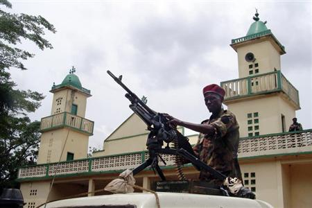 Soldiers from the Seleka rebel alliance stand guard as the Central African Republic's new President Michel Djotodia (not pictured) attends Friday prayers at the central mosque in Bangui March 29, 2013. REUTERS/Alain Amontchi