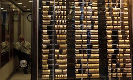 A goldsmith waits for customers at a jewellery shop at the Grand Bazaar in Istanbul April 16, 2013. REUTERS/Murad Sezer