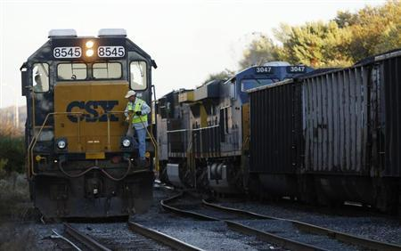 A CSX coal train (R) moves past an idling CSX engine at the switchyard in Brunswick, Maryland October 16, 2012. REUTERS/Gary Cameron