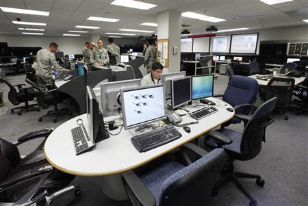 Air Force personnel work at the Air Force Space Command Network Operations & Security Center at Peterson Air Force Base in Colorado Springs, Colorado July 20, 2010. REUTERS/Rick Wilking