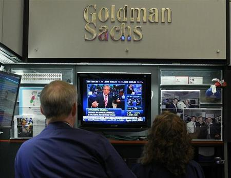 Traders work in the Goldman Sachs stall on the floor of the New York Stock Exchange July 16, 2010. . REUTERS/Brendan McDermid
