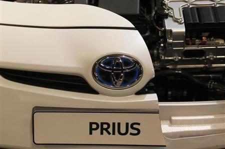 A logo of a Toyota Prius car is pictured at an exhibition stand of the 'International CAR Symposium' in Bochum January 29, 2013. REUTERS/Ina Fassbender