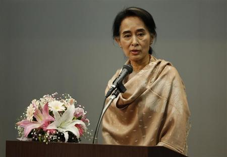Myanmar's pro-democracy leader Aung San Suu Kyi delivers a speech during a meeting with a group of Myanmar citizens residing in Japan, in Tokyo April 13, 2013. REUTERS/Issei Kato