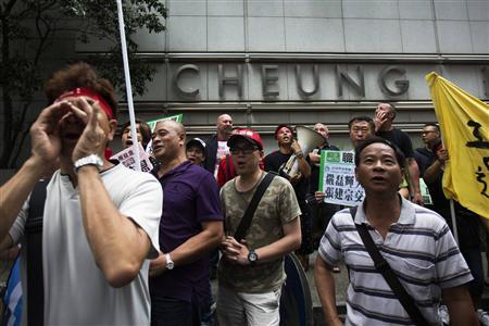 Dock workers march during a strike outside Cheung Kong centre in Hong Kong, April 17, 2013. REUTERS/Tyrone Siu