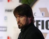 Recording artist Billy Ray Cyrus arrives on the red carpet at the Muhammad Ali Celebrity Fight Night Awards XIX in Phoenix, Arizona March 23, 2013. REUTERS/Ralph Freso