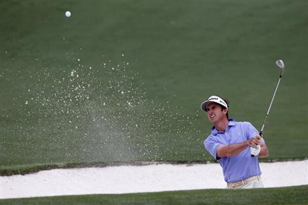 Gonzalo Fernandez-Castano of Spain hits from a sand trap on the second hole during final round play in the 2013 Masters golf tournament at the Augusta National Golf Club in Augusta, Georgia, April 14, 2013. REUTERS/Mike Segar