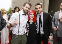 Jeremy Davis (L), Hayley Williams and Taylor York, of the band Paramore, arrive at the 2013 MTV Movie Awards in Culver City, California April 14, 2013. REUTERS/Danny Moloshok