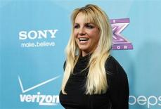 "Judge Britney Spears poses at the party for the television series ""The X Factor"" finalists in Los Angeles, California November 5, 2012. REUTERS/Mario Anzuoni"