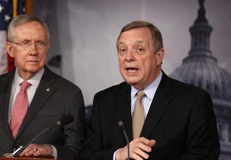 Senator Dick Durbin (D-IL) speaks next to Senate Majority Leader Harry Reid (D-NV) (L) at a news conference on Capitol Hill in Washington February 28, 2013. REUTERS/Larry Downing