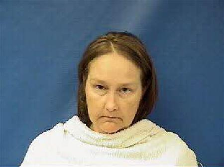 Kim Williams, the wife of the former Kaufman County, Texas, justice of the peace, is shown in this booking photo released on April 17, 2013. REUATERS/Kaufman County Sheriff's Office/Handout