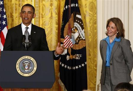 U.S. President Barack Obama stands next to Sylvia Mathews Burwell, head of the Walmart Foundation, while nominating her to become director of the White House Office of Management and Budget in the East Room of the White House in Washington, March 4, 2013. REUTERS/Larry Downing