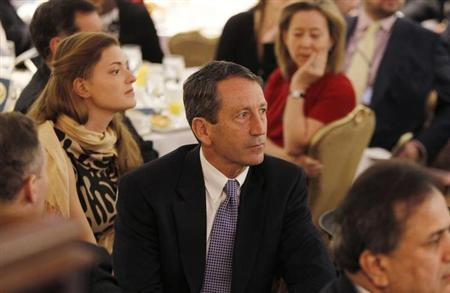 Former South Carolina Governor Mark Sanford (C) is pictured in the audience as U.S. President Barack Obama delivers remarks at the National Prayer Breakfast in Washington February 4, 2010. REUTERS/Jason Reed