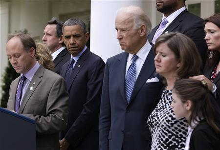 U.S. President Barack Obama (3rd L) stands next to Vice President Joe Biden and family members of Newtown victims, during an event on commonsense measures to reduce gun violence, in the Rose Garden of the White House in Washington, April 17, 2013. REUTERS/Yuri Gripas