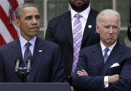U.S. President Barack Obama speaks next to Vice President Joe Biden on commonsense measures to reduce gun violence, in the Rose Garden of the White House in Washington April 17, 2013. REUTERS/Yuri Gripas