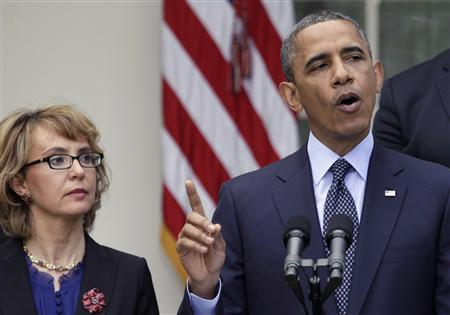 U.S. President Barack Obama speaks next to former Rep. Gabby Giffords on commonsense measures to reduce gun violence, in the Rose Garden of the White House in Washington April 17, 2013. REUTERS/Yuri Gripas