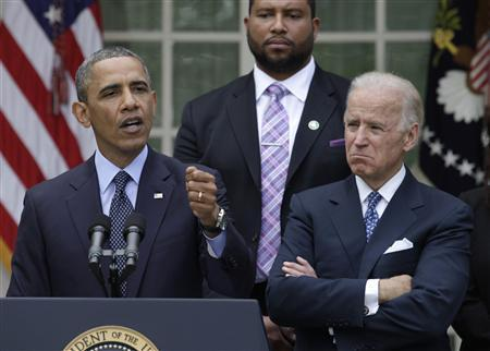 U.S. President Barack Obama (L) speaks alongside with Vice President Joe Biden and family members of Newtown victims on commonsense measures to reduce gun violence in the Rose Garden of the White House in Washington, April 17, 2013. REUTERS/Yuri Gripas