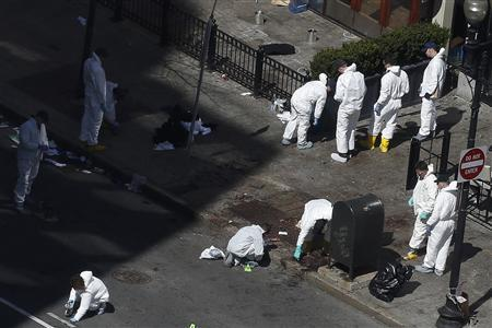 Officials take crime scene photos two days after two explosions hit the Boston Marathon in Boston, Massachusetts April 17, 2013. REUTERS/Shannon Stapleton