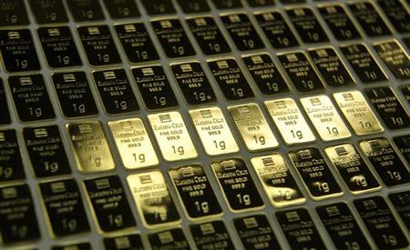 One gram gold bars are pictured side-by-side at the Zlatarna Celje in Celje, April 17, 2013. REUTERS/Srdjan Zivulovic