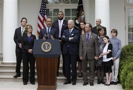 U.S. President Barack Obama speaks alongside with Vice President Joe Biden and family members of Newtown victims on commonsense measures to reduce gun violence in the Rose Garden of the White House in Washington, April 17, 2013. REUTERS/Yuri Gripas