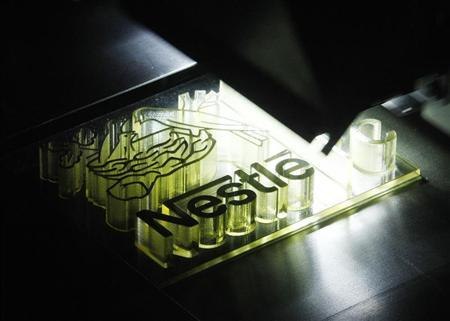A Nestle logo is printed by a 3D printer during a display for the inauguration of the system technology centre for the design, development and deployment of their products in Orbe March 25, 2013. Nestle celebrates also the 75th anniversary of Nescafe. REUTERS/Denis Balibouse