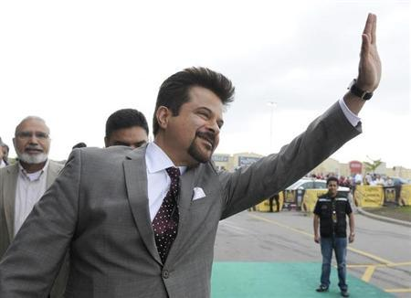 Bollywood actor Anil Kapoor waves to fans at the gala opening of the film 'Chillar Party' in Brampton June 24, 2011. REUTERS/Mike Cassese/Files
