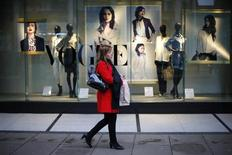 A pedestrian walks past a branch of Marks and Spencer on Oxford Street, central London April 11, 2013.REUTERS/Andrew Winning