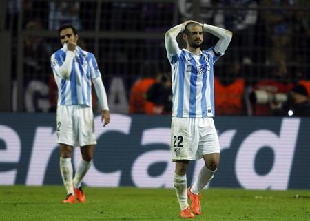 Malaga's Isco (R) walks from the pitch dejected after defeat to Borussia Dortmund in the Champions League quarter-final second leg soccer match, in the western German city of Dortmund April 9, 2013. REUTERS/Ina Fassbender