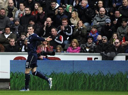 Tottenham Hotspur's Gareth Bale celebrates in front of the Swansea City fans after scoring a goal during their English Premier League soccer match at the Liberty Stadium in Swansea, March 30, 2013. REUTERS/Rebecca Naden