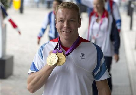 Olympic cyclist Chris Hoy poses for photographers as he arrives for a reception for British Olympic and Paralympic athletes in London September 10, 2012. REUTERS/Neil Hall