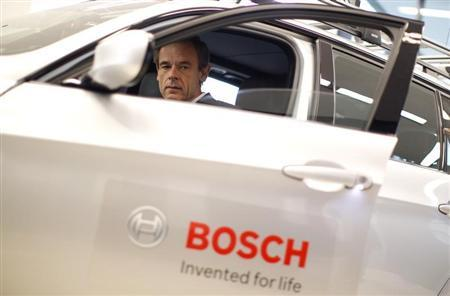 Volkmar Denner, chairman of the board of management of Bosch, sits in a car ahead of the annual news conference in Stuttgart April 18, 2013. REUTERS/Lisi Niesner (GERMANY - Tags: BUSINESS) - RTXYQE1