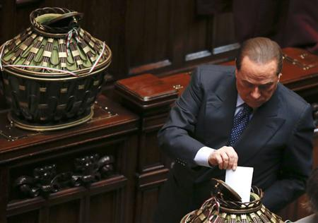 Italy's former Prime Minister Silvio Berlusconi casts his ballot during the presidential election in the lower house of the parliament in Rome April 18, 2013. REUTERS/Tony Gentile