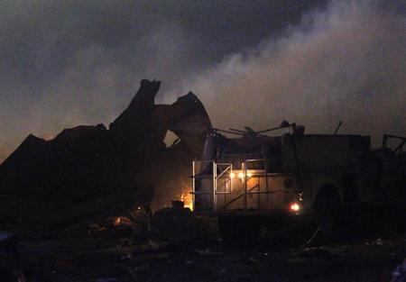 The remains of a fertilizer plant burn after an explosion at the plant in the town of West, near Waco, Texas early April 18, 2013. REUTERS/Mike Stone