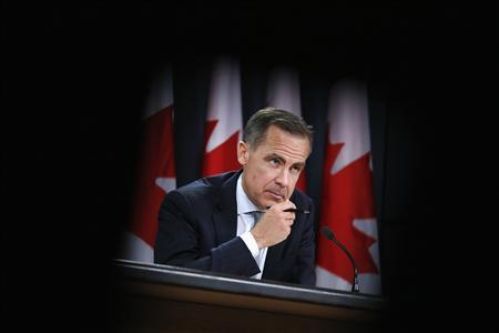 Bank of Canada Governor Mark Carney is framed by seats while taking part in a news conference upon the release of the Monetary Policy Report in Ottawa April 17, 2013. REUTERS/Chris Wattie