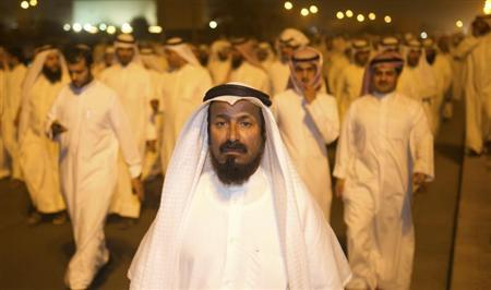 Supporters of Kuwaiti former member of parliament and opposition politician Musallam al-Barrak march towards the central prison in Andulos, after a ruling sentenced Barrak to jail for insulting the emir, April 15, 2013. REUTERS/Stephanie McGehee