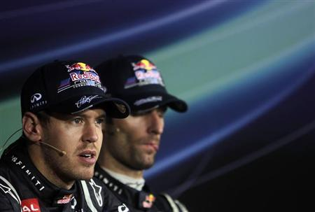 Red Bull Formula One driver Sebastian Vettel (L) of Germany and team mate Mark Webber of Australia attend a news conference after the Indian F1 Grand Prix at the Buddh International Circuit in Greater Noida, on the outskirts of New Delhi, October 28, 2012. REUTERS/Vijay Mathur/Files