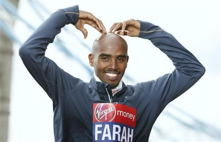Britain's double Olympic champion Mo Farah makes his trademark ''Mobot'' pose for photographers during a media event for the London Marathon, at Tower Bridge in London April 18, 2013. REUTERS/Suzanne Plunkett