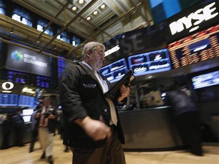 Traders work on the floor at the New York Stock Exchange, April 16, 2013. REUTERS/Brendan McDermid