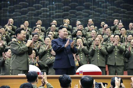 Military officials applaud together with North Korean leader Kim Jong-un, during the Unhasu concert in Pyongyang, in this picture released by North Korea's KCNA news agency April 16, 2013. REUTERS/KCNA