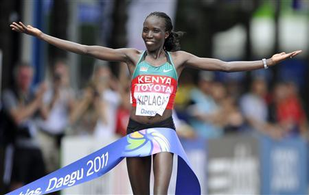 Edna Kiplagat of Kenya celebrates as she wins the women's marathon final at the IAAF World Championships in Daegu August 27, 2011. REUTERS/Dylan Martinez