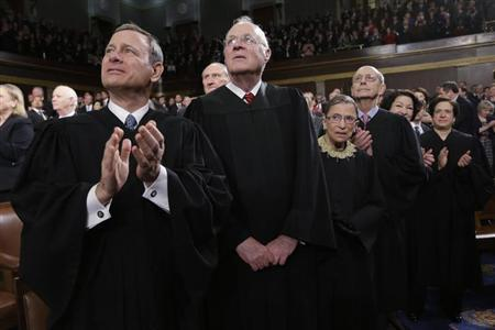 U.S. Supreme Court Justices Chief Justice John Roberts, Anthony Kennedy, Ruth Bader Ginsburg, Stephen Breyer, Sonia Sotomayor and Elena Kagan (L-R) applaud prior to President Obama's State of the Union speech on Capitol Hill in Washington, February 12, 2013. REUTERS/Charles Dharapak/Pool
