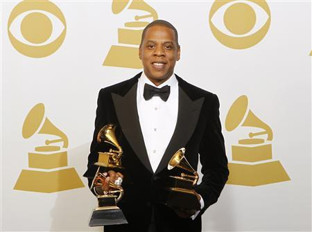 Jay-Z poses with the awards he won for Best Rap Performance, Best Rap/Sung Collaboration and Best Rap Song backstage at the 55th annual Grammy Awards in Los Angeles, California February 10, 2013. REUTERS/Mario Anzuoni