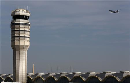 A jet departs Washington's Reagan National Airport next to the control tower outside Washington, in this February 25, 2013 file photo. REUTERS/Larry Downing/Files