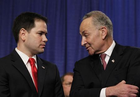 Members of the U.S. Senate's ''Gang on Eight'' (L-R) Chuck Schumer (D-NY) and Marco Rubio (R-FL) chat during a news briefing on Capitol Hill in Washington, April 18, 2013. REUTERS/Jason Reed
