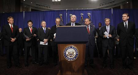 The U.S. Senate's ''Gang of Eight'' are pictured during a news briefing on Capitol Hill in Washington, April 18, 2013. REUTERS/Jason Reed